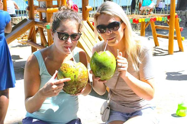 Enjoying a fresh coconut